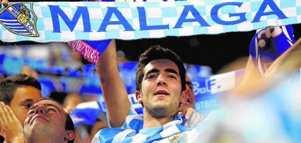 Bufandas para combatir la pachorra en el Málaga-Deportivo
