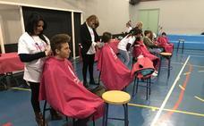 Un colegio se convierte en peluquería por una buena causa