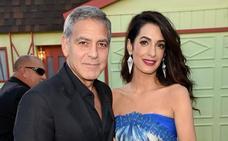 Amal y George Clooney acogen a un refugiado en casa