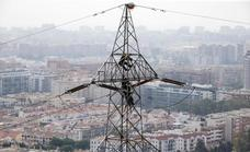 Firefighters rescue man from top of high-voltage electricity pylon in Malaga