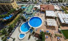 Holidaying police officers help save the life of man found at bottom of hotel swimming pool