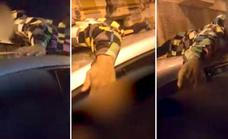 Motorist faces charges for reckless driving with a youth on the roof of his car