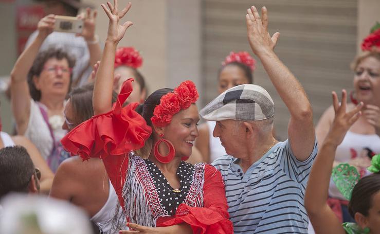Así vive este domingo Málaga su feria del centro