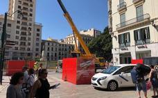 Comienza la instalación de la portada de la Feria de Málaga 2018 de la calle Larios