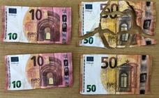 Tres detenidos por intentar colocar billetes falsos de 10 y 50 euros en Torrox