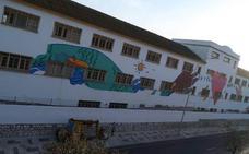 El colegio Sagrada Familia se funde con el barrio de El Palo