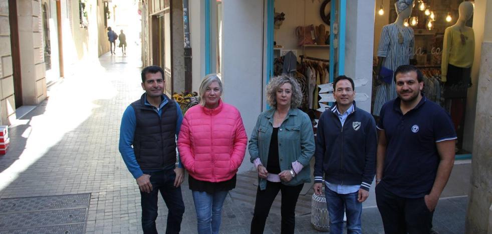 La familia de comerciantes de la calle Andrés Pérez de Málaga