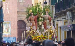 Los Santos Patronos de Málaga recorren las calles del Centro en las vísperas de su festividad