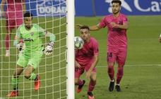 Malaga steady themselves with hard-fought away draw
