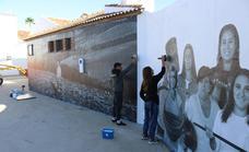 Cuevas del Becerro se engancha al arte urbano con un 'paste up' a la mujer rural