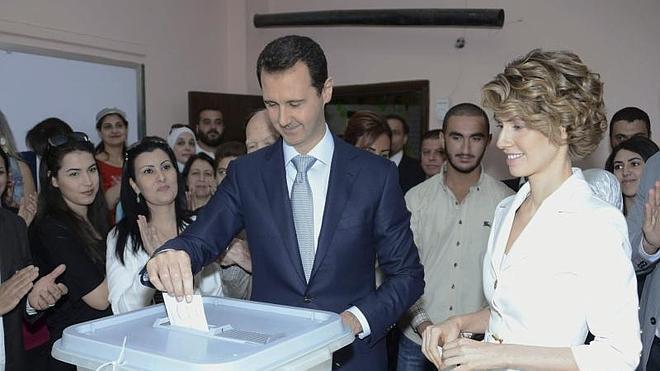 Cientos de sirios salen a calles de Damasco para celebrar triunfo de Al Asad